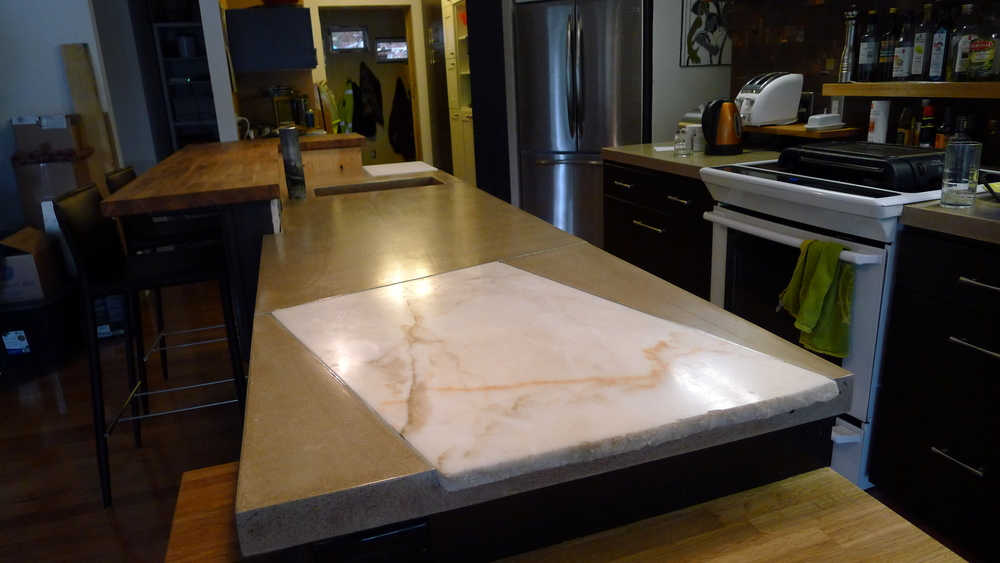 Inlaid marble in concrete counters.
