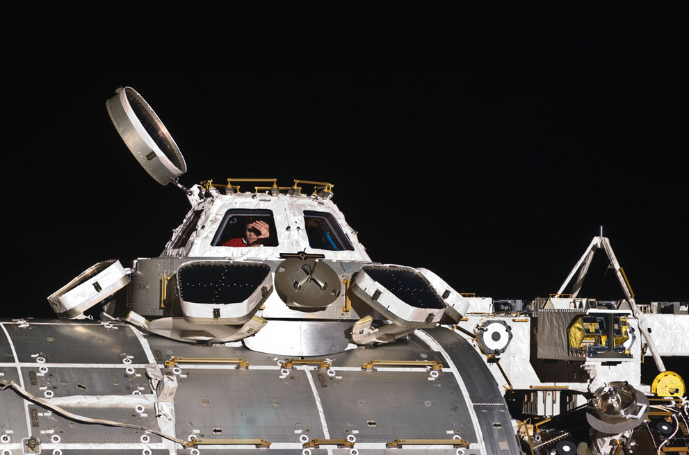 ESA astronaut waving. Inspiring photos via  In Focus, the Atlantic: The International Space Station expedition 26