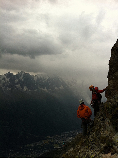 Go for it or bail now? on Flickr. From the GMail archives, Polly and I debating trying to outrun or bail because of the weather moving in. Photo by Severin Marchand, a guide we met on the Aiguille l'Index in Chamonix last year.