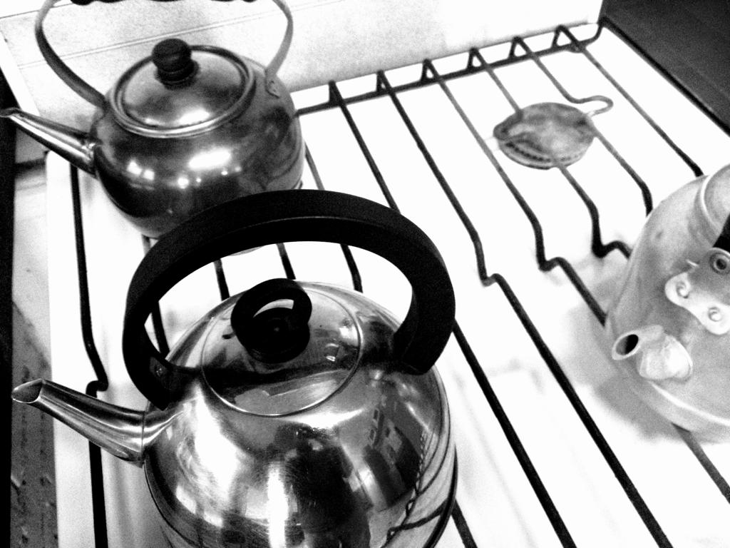 3 tea pots. Everyone wants tea on a rainy day.