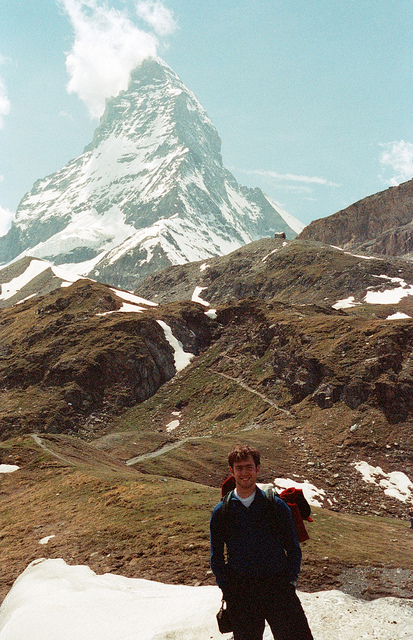 Me, and the Matterhorn  on Flickr.   Via Flickr:   From an undeveloped roll of film I found this winter cleaning out a box from my basement.     This was from a trip to Switzerland during a summer interning in France. We didn't summit (hadn't gotten into climbing yet), but we did bivy just below were the Hornli Ridge route starts, one of the coldest nights of my life. All the film from the two rolls has an orange cast two it, but for 9 years old, can't complain.