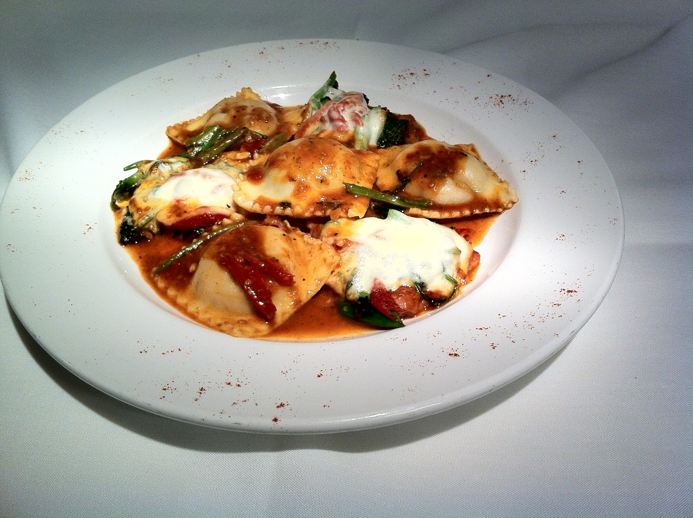 Grilled vegetable Ravioli with Veal Medallions and Asiago Cheese