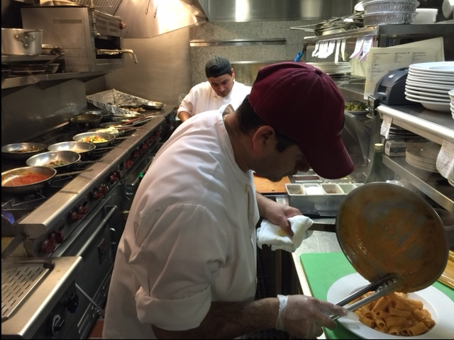 Lead Chef Rigoberto plating fresh made rigatoni