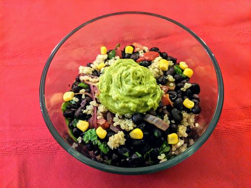 Vegetarian Bowl: Beans, spinach, quinoa, corn, peppers, onions & guacamole