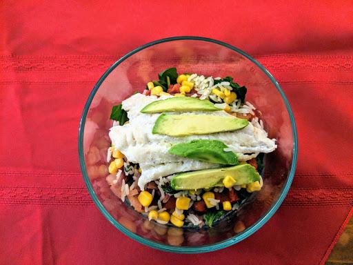 Fish Bowl: Chicken, spinach, quinoa, corn, peppers, onions & avocado