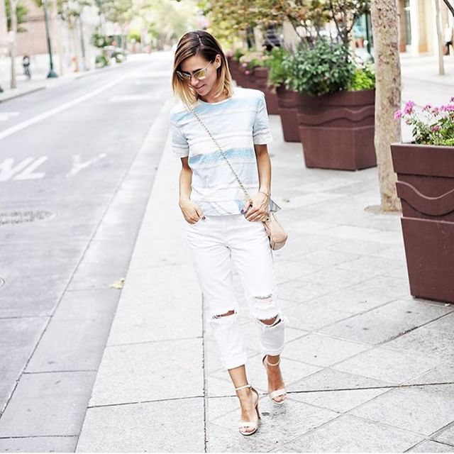 We love this cooled off look from style blogger @mksportsanista, white is always in fashion when it's hot out. 🌞 Follow her for more great posts. #ootd #regram #style #streetstyle.
