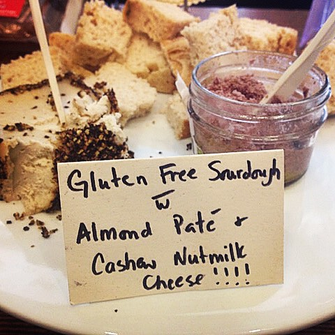It's a yummy humpday sample treat at Isabella's! Top this delicious @breadsrsly Gluten Free Sourdough with @punkrawklabs Smoked Cashew Nutmilk cheese and finish with a touch of raw and fermented Almond Pate. Your tastebuds will be dancing and your belly will be thanking you for all those amazing probiotics! #raw #fermented #vegan #glutenfree #paleo #artisan #shoplocal #santabarbara #nutmilkcheese