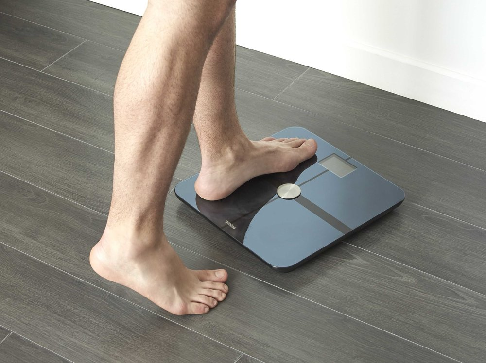 A smart-scale measures weight, body fat % and possibly bone mass and water mass via electrical impedance