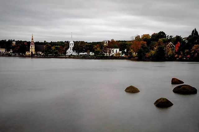 Three churches, Mahone Bay, Nova Scotia. I would have liked to get tighter but I like the foreground rocks and the fall colours. #mahonebay #novascotia #longexposure #fall #autumn #fujifilm #fujifilmxt1