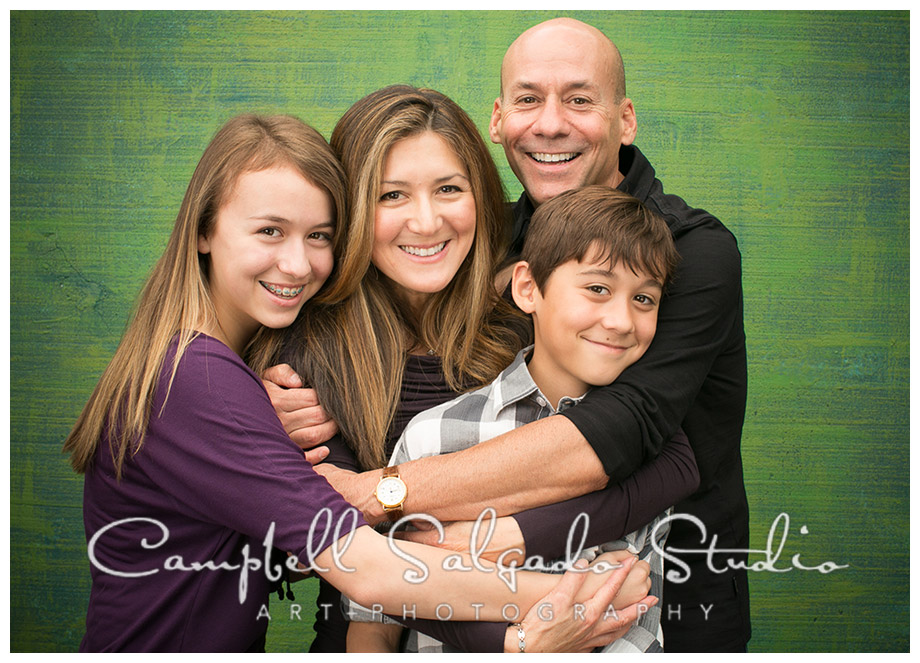 Portrait of family against green background by Campbell Salgado Studio.