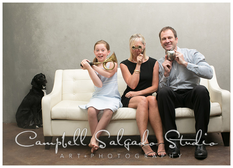 Portrait of family with silly props on grey background by Portland photographers Campbell and Salgado.