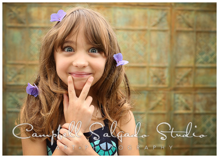 Portrait of young girl with flowers in her hair on tin background by Campbell Salgado Studio.