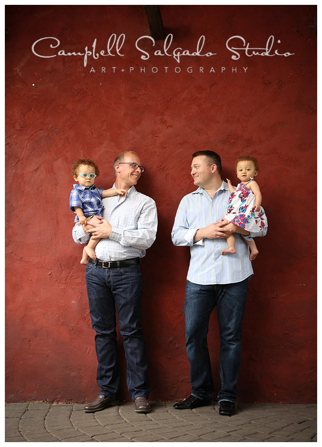 Portrait of family on red background in Portland, Oregon by Campbell Salgado Studio.