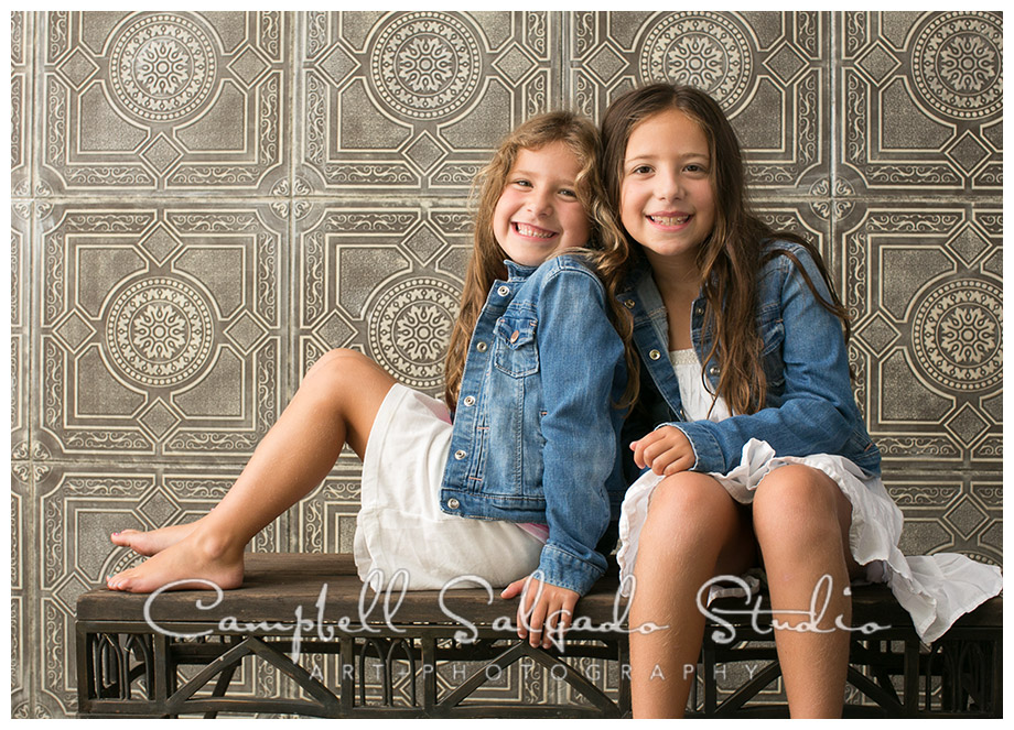 Portrait of girls on vintage tile background at Campbell Salgado Studio.