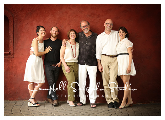 Family portrait photography in front of a red background at Campbell Salgado Studio in Portland, Oregon.