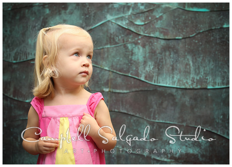 Portrait of little girl on copper background in Portland, Oregon by Campbell Salgado Studio.