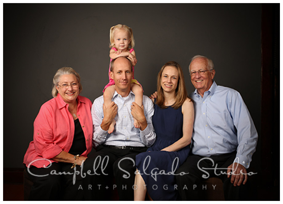 Portrait of family on grey background by Campbell Salgado Studio.