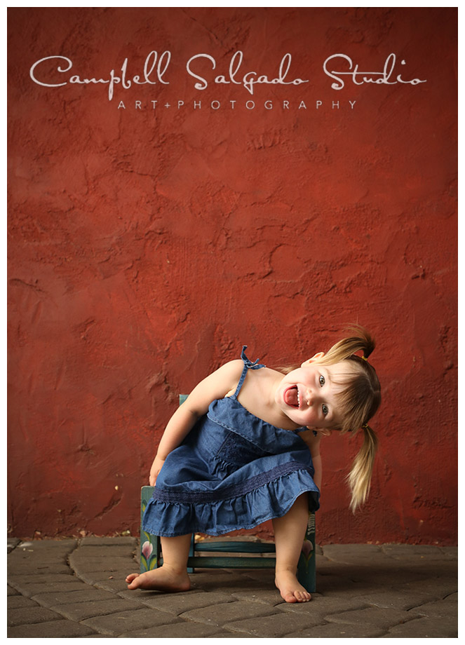 Portrait of little girl on red background at Campbell Salgado Studio.