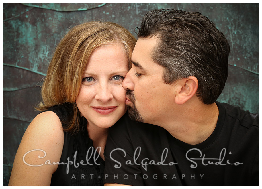 Portrait of couple on copper background by Portland photographers Campbell and Salgado.