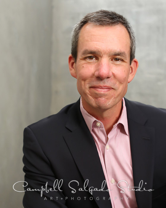 Commercial portrait of man on grey background by Campbell Salgado Studio.