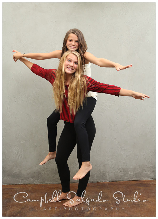 Portrait of girls on grey background in Portland, Oregon at Campbell Salgado Studio.