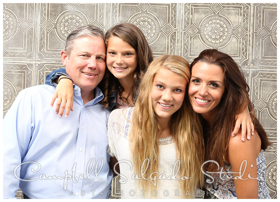 Portrait of family on vintage tile background by Campbell Salgado Studio.
