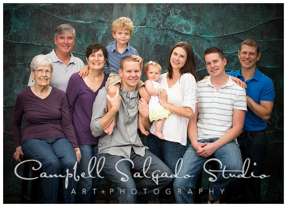 Portrait of family on copper background by Portland photographers Campbell and Salgado.