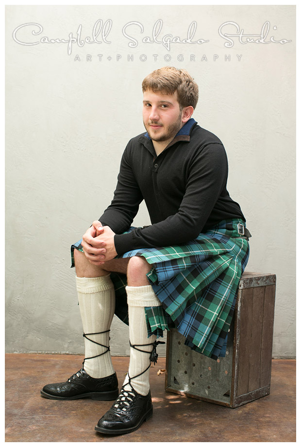 Portrait of man in kilt on grey background in Portland, Oregon by Campbell Salgado Studio.