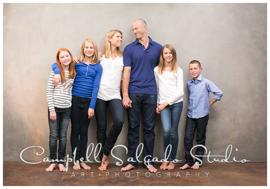 Portrait of family on grey background in Portland, Oregon by Campbell Salgado Studio.