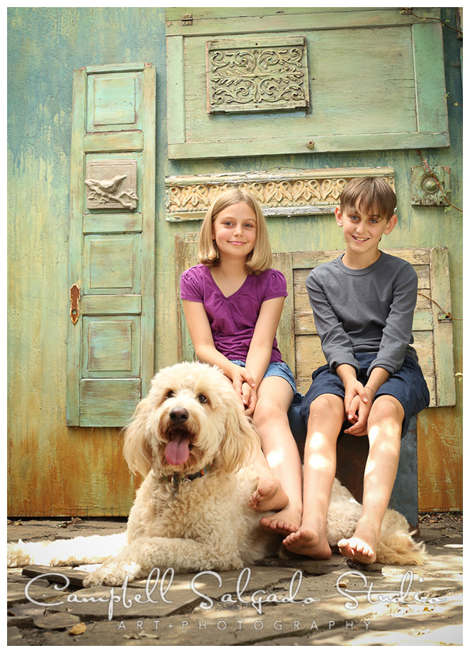 Portrait of kids and their dog on vintage doors background at Campbell Salgado Studio in Portland, Oregon.