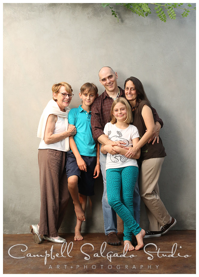 Portrait of family on grey background at Campbell Salgado Studio in Portland, Oregon.
