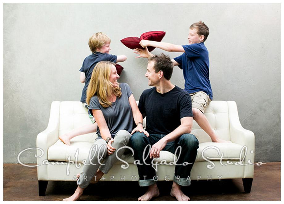 Portrait of family having pillow fight at Campbell Salgado Studio.