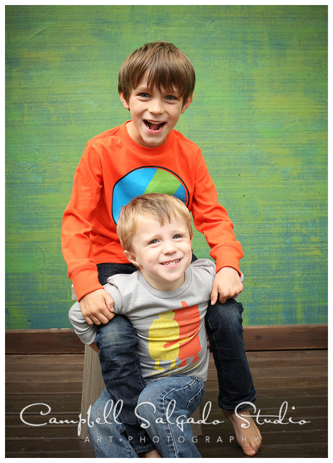 Portrait of young boys on green background at Campbell Salgado Studio.