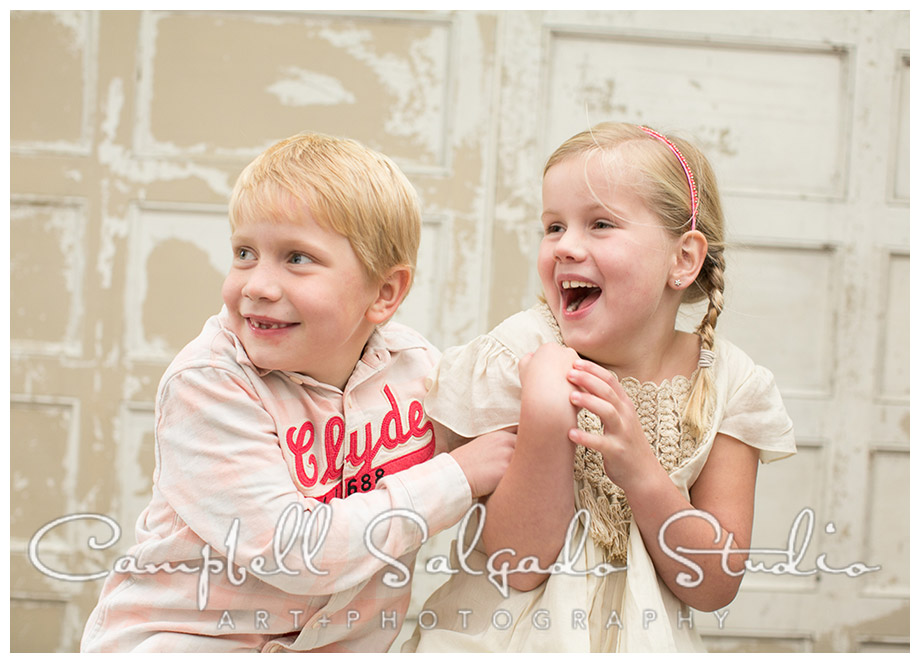 Portrait of siblings on vintage door background by Portland photographers Campbell and Salgado.