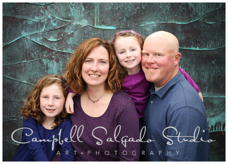 Portrait of family on copper background at Campbell Salgado Studio in Portland, Oregon.