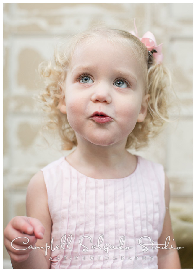 Portrait of little girl on vintage door background at Campbell Salgado Studio.