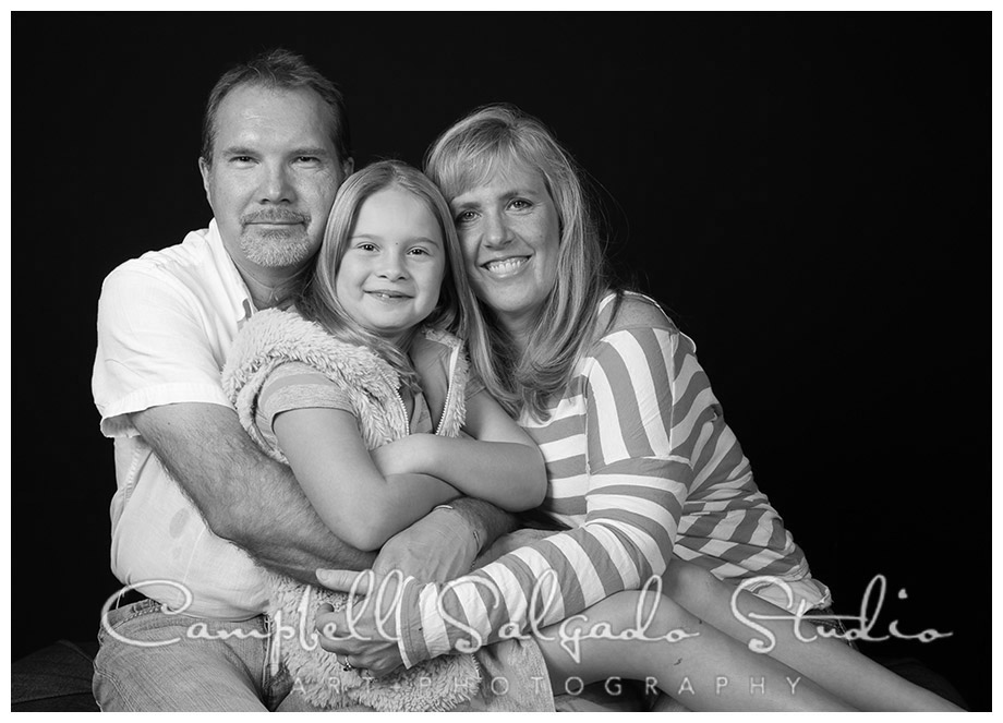 B&W portrait of family on black background at Campbell Salgado Studio.