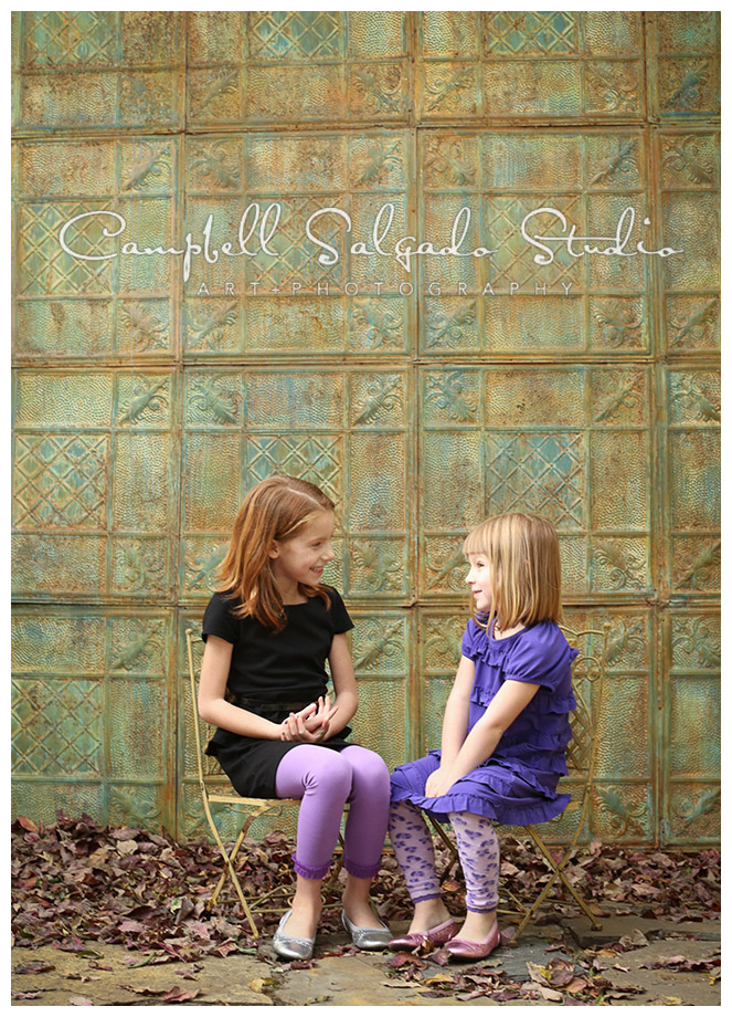 Portrait of sisters on tin background by photographers Campbell and Salgado.