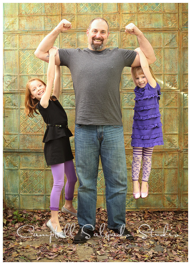 Portrait of dad and daughters on tin background at Campbell Salgado Studio in Portland, Oregon.