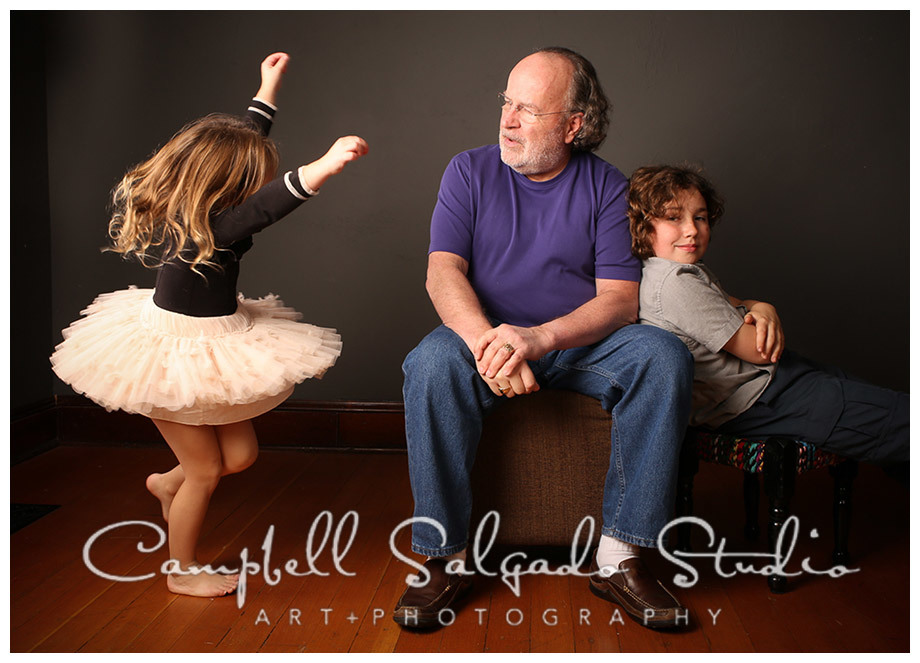 Portrait of grandchildren and grandfather at Campbell Salgado Studio on grey background.