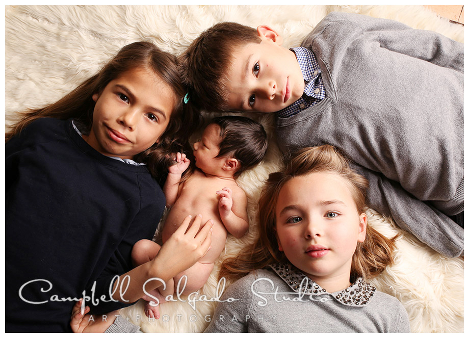 Portrait of siblings with new baby at Campbell Salgado Studio.