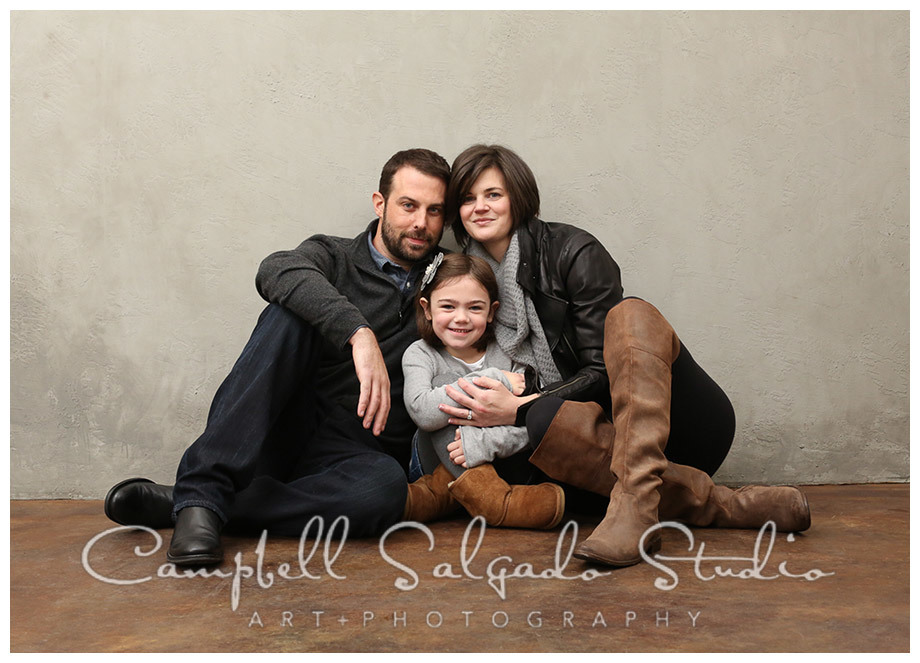 Portrait of family on grey background at Campbell Salgado Studio.