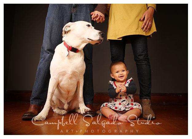 Baby photographers capture dog and baby at Campbell Salgado Studio in Portland, Oregon.