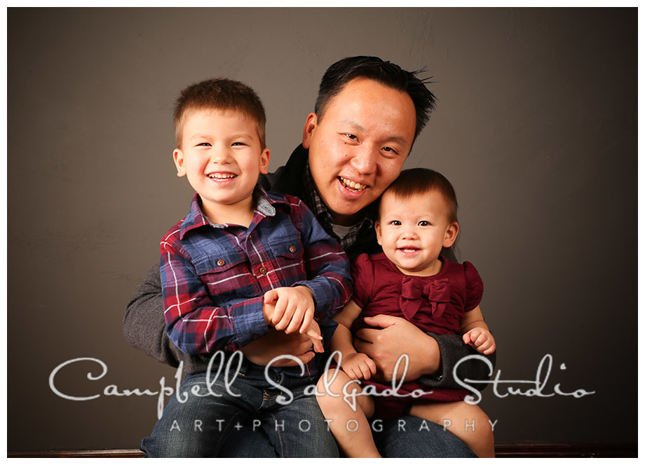 Portrait of dad and kids on grey background in Portland, Oregon at Campbell Salgado Studio.