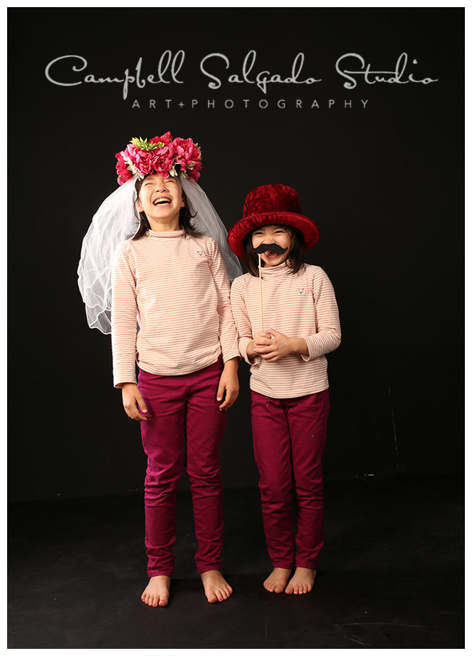 Portrait of girls playing dress up at Campbell Salgado Studio.