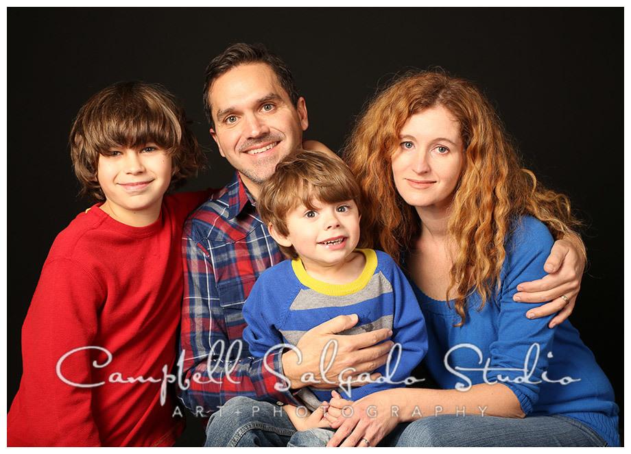 Portrait of family on black background in Portland, Oregon at Campbell Salgado Studio.