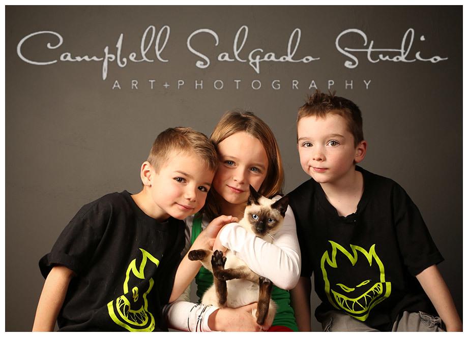 Portrait of kids on indoor grey background in Portland, Oregon at Campbell Salgado Studio.