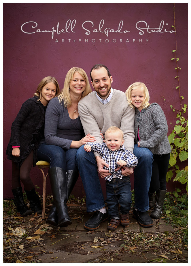 Portrait of family on plum background at Campbell Salgado Studio.
