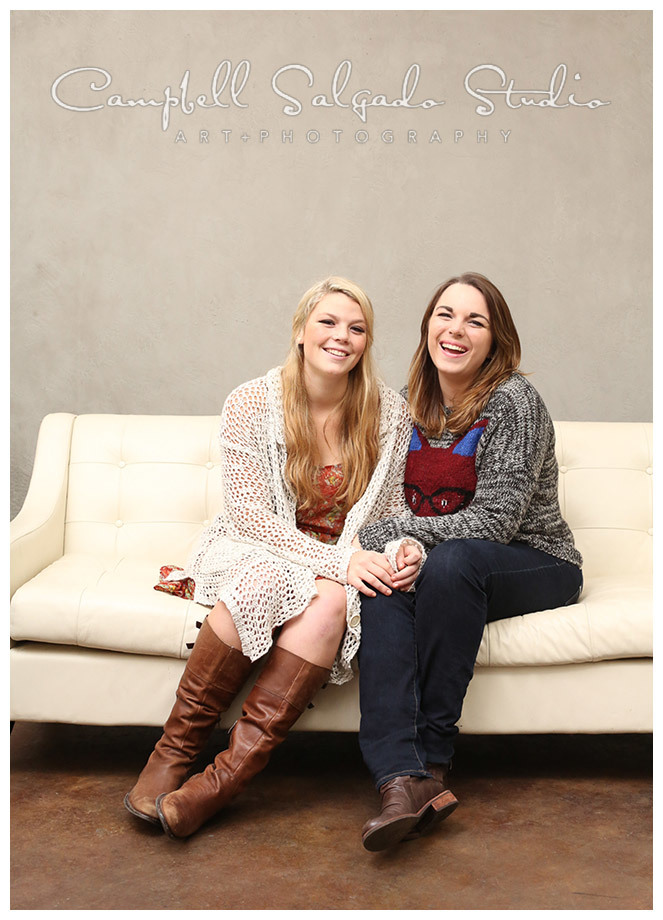 Portrait of sisters on white couch at Campbell Salgado Studio.