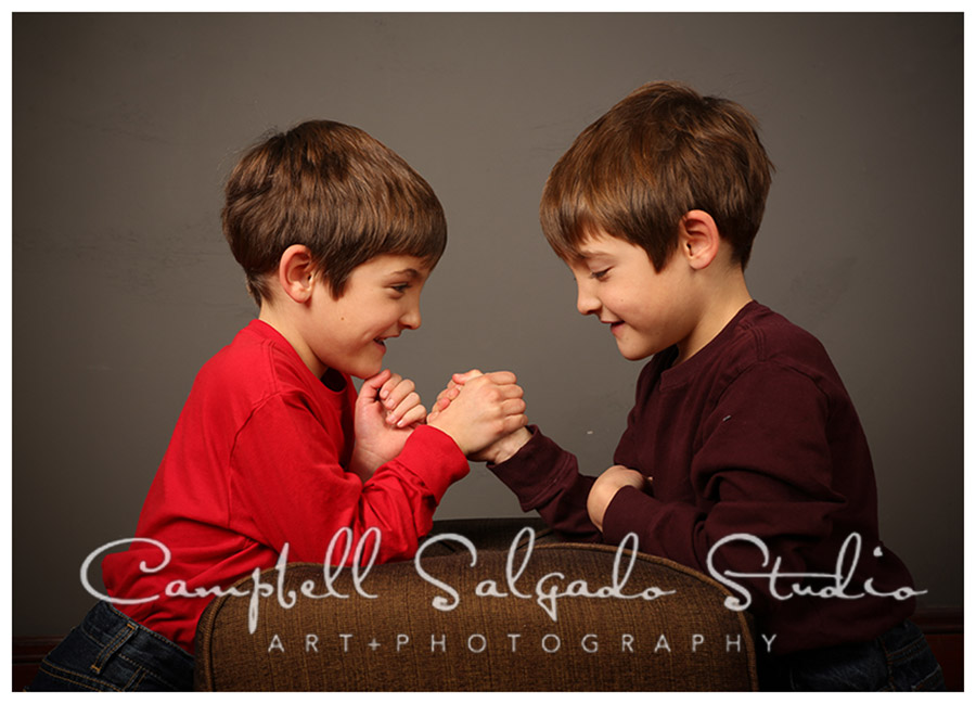 Portrait of twin boys on grey background at Campbell Salgado Studio.